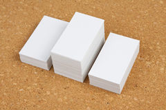 Three piles of business cards on corkboard backgroun. Stock Photography