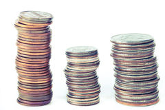 Three piles of coins Stock Image