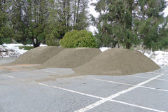 Three Piles of  Earth on the Ground in a Parking Lot Stock Image