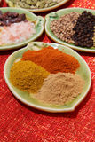 Three piles of indian powder spice on plate Royalty Free Stock Photography
