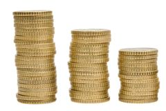Three piles of money Stock Photo