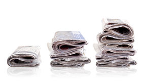 Three piles of newspaper Stock Images