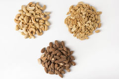 Three Piles of Nuts Royalty Free Stock Images