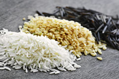 Three piles of rice Stock Photography