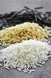 Three piles of rice Stock Image