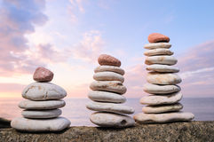 Three piles of white pebbles Stock Photography