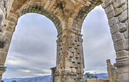 Three pillars of Roman Arch of Caparra, Caceres, Spain Royalty Free Stock Image