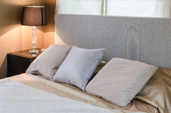 Three pillows on bed in bedroom Stock Image