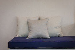 Three pillows on blue sofa in living room Royalty Free Stock Images