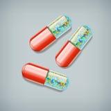 Three pills Stock Photos
