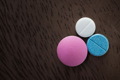 Free Three Pills On The Table Royalty Free Stock Images - 83375779