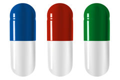 Three pills Stock Images