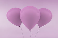 Three Pink Balloons. Set against a pink packground Royalty Free Stock Photo