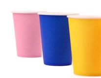 Three pink blue and yellow paper cups Royalty Free Stock Photo