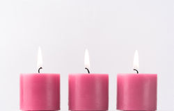 Three pink candles. Three romantic pink candles, room for copy Stock Image
