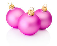 Three pink christmas balls Isolated on white background Royalty Free Stock Photo