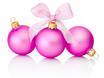 Three pink christmas balls with ribbon bow Isolated on white Stock Photo