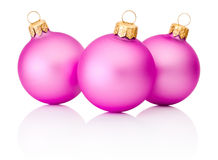 Three pink Christmas baubles on white background Royalty Free Stock Photography