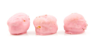 Three pink  cream puffs in a row Royalty Free Stock Photography