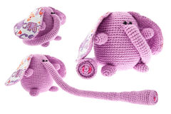 Three pink elephants with long trunk. Crochet toys. Isolated on white background Royalty Free Stock Photos
