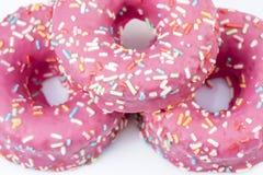 Three pink glazed donuts Stock Photo