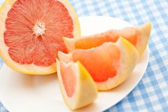 Three pink grapefruit segments Stock Photography