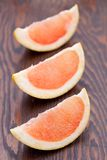 Three pink grapefruit segments Stock Image