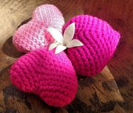 Three pink hearts and one fragant white flower Royalty Free Stock Photo