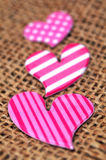 Three pink hearts. Valentines day background with pink hearts over jute Stock Photography