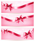 Three pink holiday banners with gift glossy bow an Royalty Free Stock Images