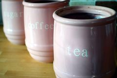 Three pink jugs on a wooden kitchen work surface, with the words royalty free stock photos