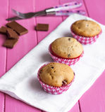 Three pink muffins. On the pink table royalty free stock image
