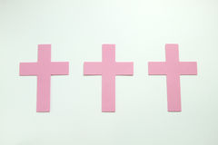 Three Pink Pastel Christian Crosses isoleted on white background Royalty Free Stock Photos