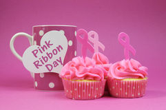 Three Pink Ribbon cupcakes with coffee cup Stock Image
