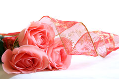 Three pink roses and ribbon Royalty Free Stock Photos