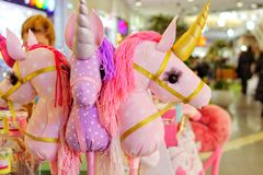 Pink unicorns, mythical toys royalty free stock image