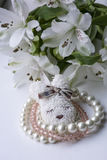 Three pink and white bracelets with brooch and white flowers Stock Images
