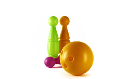 Three pins and ball on a white background. Stock Image