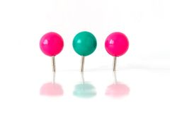 Three pins. Three push pins isolated on white background royalty free stock photography