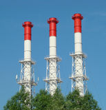 Three pipe heat and power plant. Three red and white pipe heat and power plant stock photography