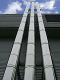Three pipes rising highly in the sky Stock Images