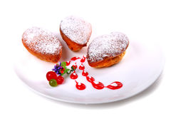 Three pirozhki covered with powder Royalty Free Stock Photography