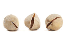 Three Pistachio Nuts. Three Cracked and Dried Pistachio Nuts  on White Stock Photos