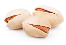 Three pistachio nuts on white Stock Photography
