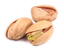 Three pistachios close up. Stock Photo
