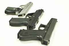 Three pistols. Isolated over a white background Stock Photography