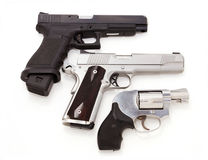 Three pistols. Three modern pistols isolated on white background Stock Photography