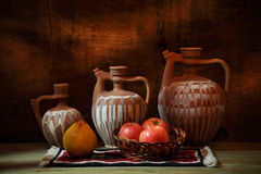 Three pitchers and apples Royalty Free Stock Photography