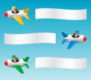 Three planes pull banners Royalty Free Stock Photos