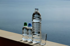 Three plastic bottles and glass Stock Photo